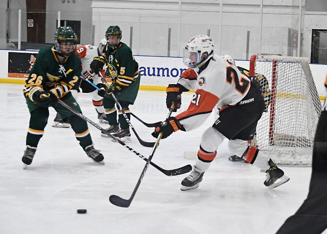 Brother Rice captain Ryan Murphy  facing Grosse Pointe North's William Weiss.