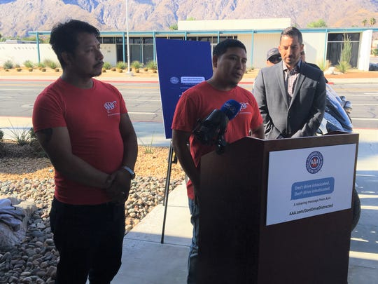 Antonio Lorenzo (right) talks on Thursday, Nov. 21, 2019 about his nieces who were killed when they were hit by a distracted driver in April 2019. He and their father, Francisco Lorenzo (left) participated in a campaign with Palm Springs police and the Automobile Club of Southern California to reduce distracted driving.