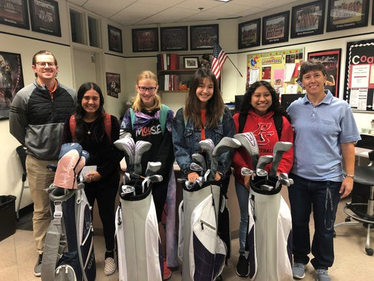 Four golfers from Palm Springs High School received new clubs though the SCPGA Foundation's Clubs for Youth program. Pictured are, from left, Matt Gilson of the SCPGA Foundation, Palm Springs High School golfers Emily Salgado, Bailee Brown, Alexa Duque and Monsserrat Luna and Palm Springs girls golf coach Deb Cormier.