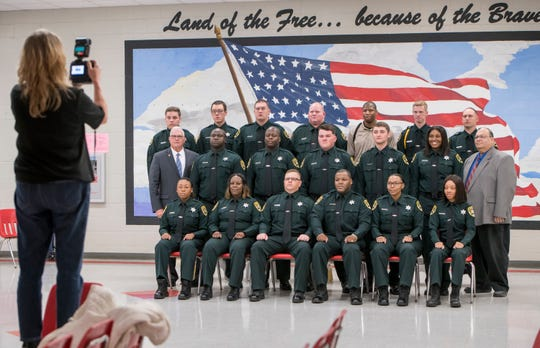 Correctional coordinator Gerald Russo, right, poses with the Corrections Academy Class No. 112 for a photo prior to the graduation ceremony at the George Stone Criminal Justice Training Center on Nov. 20.