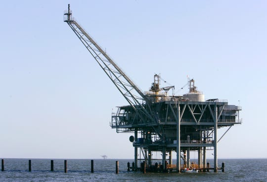 This April 13, 2007, file photo, shows a natural gas platform off the coast of Fort Morgan, Alabama. The federal agencies that make and enforce offshore oil and gas leases will encourage new wells in shallow Gulf of Mexico waters by allowing some reduced-royalty or even royalty-free production if owners can prove they need it.