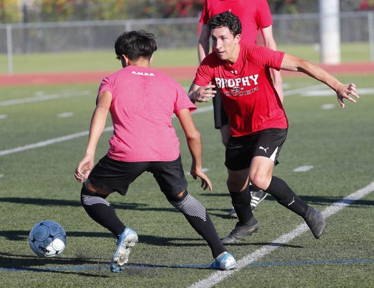 Brophy boys soccer player Francesco Montanile performs a drill during practice in Phoenix November 11, 2019.