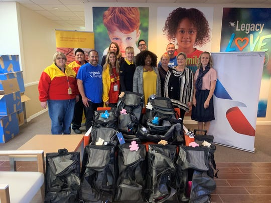 DHL and American Airlines employees came together to donate bags to Child Crisis Arizona on Nov. 21, 2019.