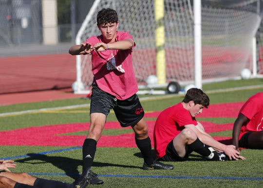 Brophy soccer player Eduardo Serrano stretches with his team during practice n Phoenix November 11, 2019.