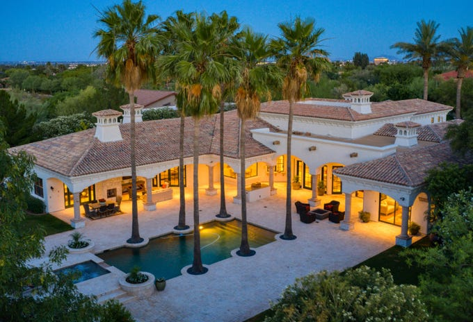 The $3.2M estate, sold by Steven Rosenfield and Linda Nash, has covered patios and an outdoor kitchen.