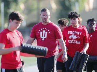 Brophy boys soccer head coach Paul Allen directs his team during practice in Phoenix November 11, 2019.