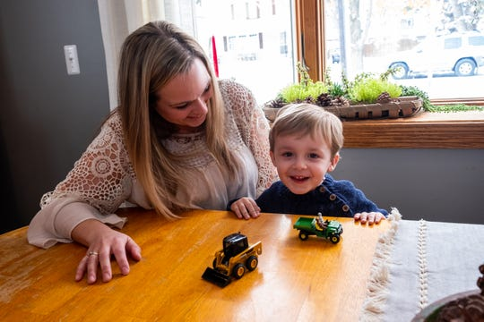 "Sara Scherf-Oles plays with her son Jack, 3, at a table in their Marysville home Wednesday, Nov. 13, 2019. Growing up, Scherf-Oles had ""a whole bunch"" of health complications that made conceiving, carrying and delivering a child almost impossible, she said. After a complicated pregnancy and a birth she describes as ""traumatic,"" Jack was born naturally."