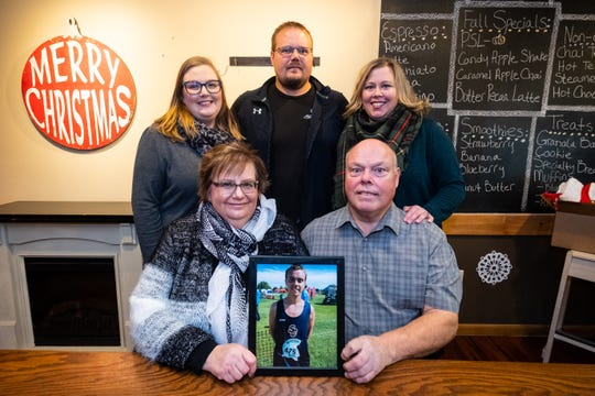 The family of Tyler Kreilter, photographed Thursday, Nov. 21, 2019, at Roasted With Perks in Marine City, are hosting a memorial run to raise funds for scholarships for Blue Water area runners that exhibit strong leadership in addition to speed on the course. Tyler Kreilter, a cross country runner at SC4, died in a car crash in 2016.