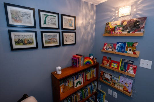 Several pieces of art made by Sara Scherf-Oles hang in the bedroom of her son Jack.