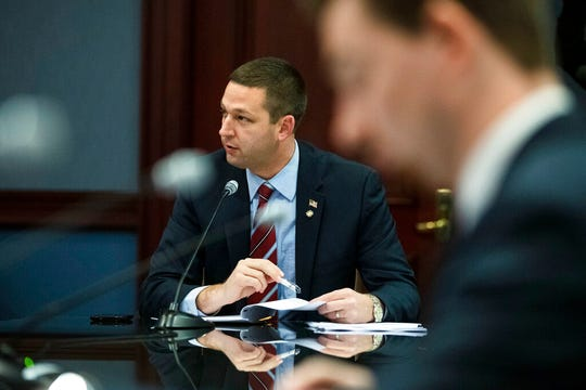 Rep. Matt Gabler, R-Clearfield, sponsors an amendment with exceptions to a gift ban bill, before the proposal's unanimous approval by the House State Government Committee during a hearing at the Pennsylvania Capitol in Harrisburg, Pa., Tuesday, Nov. 19, 2019. The bill would ban cash gifts outright and put limits on other gifts and hospitality. It was sent to the House floor unanimously. (AP Photo/Matt Rourke)