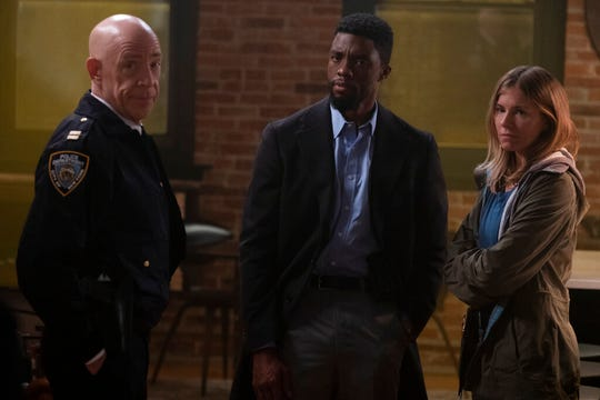 "From left, J.K. Simmons, Chadwick Boseman and Sienna Miller star in ""21 Bridges."" The movie is playing at Regal West Manchester, Queensgate Movies 13 and R/C Hanover Movies 16."