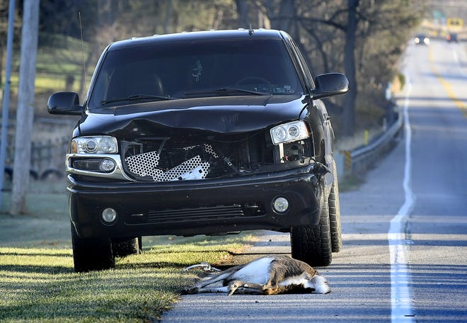 A vehicle sits along Route 616 outside Seven Valleys after apparently striking a deer Thursday, Nov. 21, 2019. Bill Kalina photo