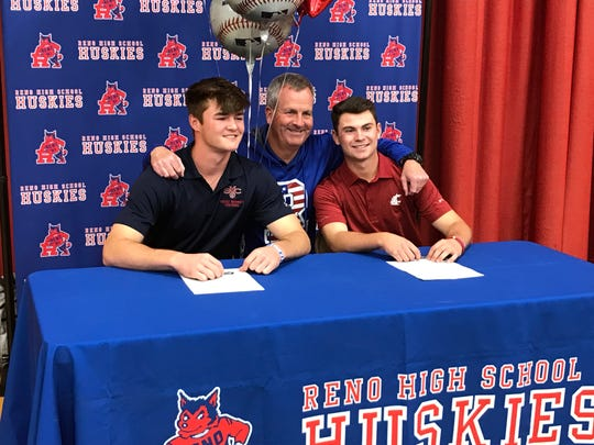 Reno High baseball players, left Coleman Schmidt and Gunnar Gouldsmith signed to play college. Coach pete Savage is in the middle.