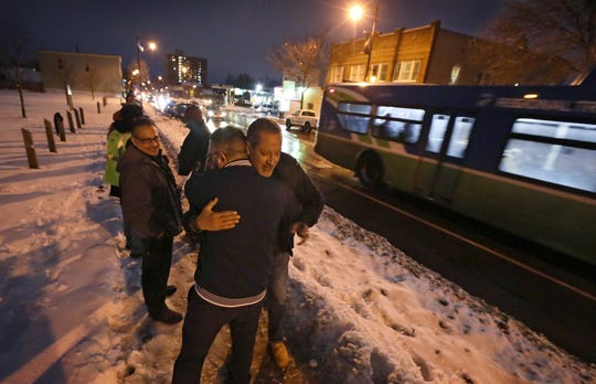 Rudy Rivera hugs each of the neighborhood residents and activists that making a human chain to disrupt the open-air heroin market and highlight poverty, lack of services, vacant properties and other challenges in the northeast, as they stood outside in the cold along N. Clinton Avenue.