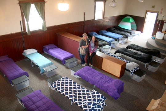Silverton Sheltering Service's executive director Hilary Dumitrescu and shelter manager Julia Marshall rest between last-minute preparations as they and other volunteers ready the new upstairs space at Oak Street Church for its 2019-20 season. The 30-bed shelter is open November through March, 8 p.m. to 8 a.m.