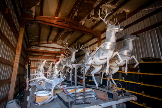 Reindeer sit along with other reindeer, a sleigh and holiday decorations in a shed waiting to be cleaned up for the holiday season. Santa's sleigh and reindeer will be back on the rooftop of one of the Gatti buildings known for elaborate holiday display of lights and decorations. The 37-year Salem tradition will be on display at the Y intersection of Liberty and Commercial streets NE on the outskirts of downtown Salem.