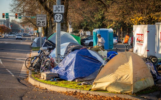 Tents line the sidewalk in front of the ARCHES building on Commercial Street in Salem November 21, 2019. The tents have spread to the sidewalk across the street from Arches as well.