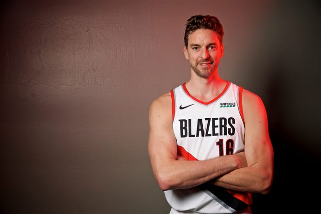 FILE - In this Sept. 30, 2019, file photo, Portland Trail Blazers' Pau Gasol poses during the NBA basketball team's media day in Portland, Ore. The Blazers have waived  Gasol, but his career with the team may not be over. Gasol, who never played in a game with the Blazers, announced on social media Tuesday, Nov. 20, that the team had released him. Gasol said he plans to remain in Portland to continue his rehabilitation after surgery for a stress fracture, and he is discussing a new role with the Trail Blazers.