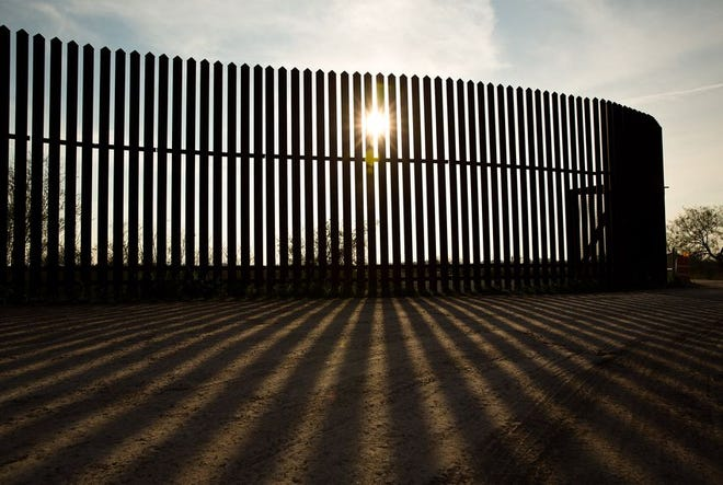 A section of the border fence along the Rio Grande in South Texas was built under George W. Bush's administration.