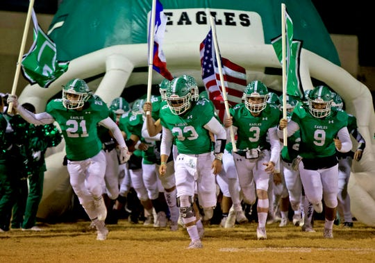 The Eldorado Eagles take to the field prior to a game Friday, Nov. 8, 2019.