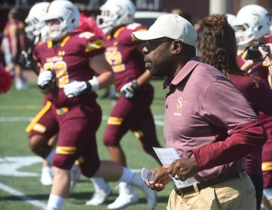 Salisbury University head coach Sherman Wood takes the field with his team prior to playing Wesley on Oct. 12, 2019.