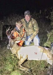 Kaden Sheat, left, and his grandfather Kevin Sheat celebrating their  successful hunt together.