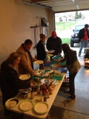 Republic residents Lora and Jeff Martinson (wearing the red hat) throw a Fry-Day party each year the day after Thanksgiving that includes tons of fried foods, both savory and sweet, along with all kinds of dips and sauces.