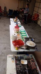 For Fry-Day, Jeff and Lora Martinson's annual day-after-Thanksgiving fried-food party, the setup includes folding tables for dips and sauces, different types of batter for frying and plenty of newspaper to soak up the grease.