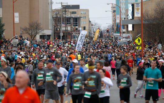 People participate in the Turkey Trot 5K Run/Walk of 2015. About 7,700 runners took part that year. The race debuted back in 1995, when 142 people crossed the finish line on a morning when it was 17 degrees.