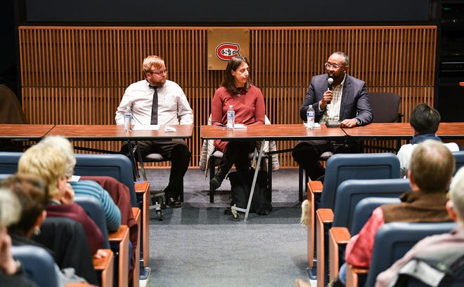 Outfront Minnesota Organizer Justin Lewandowski, National Council of Jewish Women Minnesota Executive Director Beth Gendler and CAIR-MN Executive Director Jaylani Hussein take part in a forum on bias Wednesday, Nov. 20, 2019, at the Miller Center at St. Cloud State University.