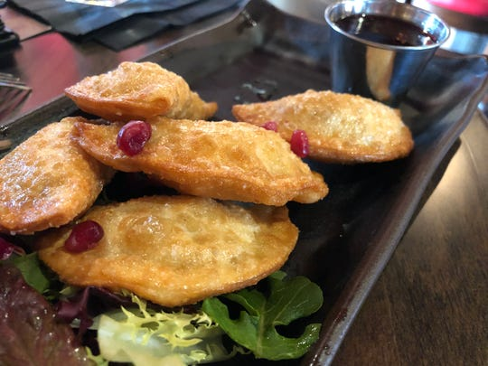 The duck bacon wontons came lightly garnished with pomegranate seeds and a side of pomegranate Sriracha dipping sauce.