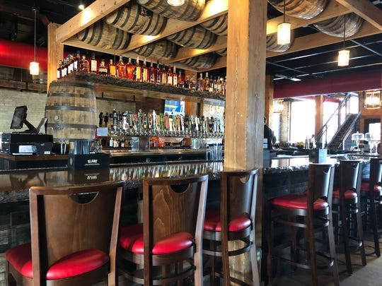 Brick & Bourbon's interior is modern and features a prominent bar, which splits the restaurant into front and back.