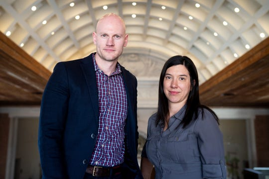 Researchers James Densey and Jillian Peterson stand for a portrait at Hamline University in St. Paul on Tuesday, March 19, 2019. Densey and Peterson are co-founders of Tbe Violence Project, a research and training organization with the mission of reducing violence in society. (Evan Frost/Minnesota Public Radio via AP)
