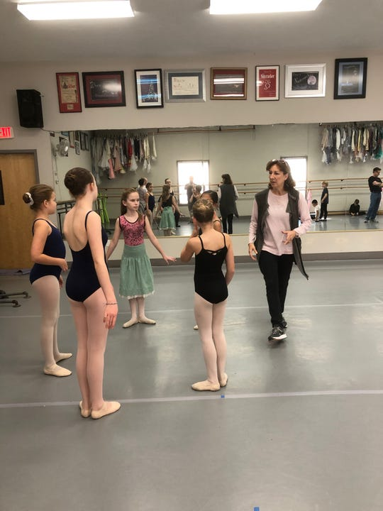 "Nathalie Botha directs young dancers in preparation for ""The Nutcracker."""