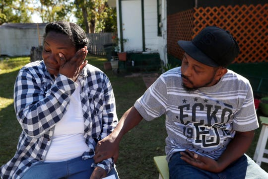 Tiffany Zachery, mother of 16-year-old Amarion James, who was shot and killed last weekend, wipes away her tears as her husband Reshard Zachery comforts her.