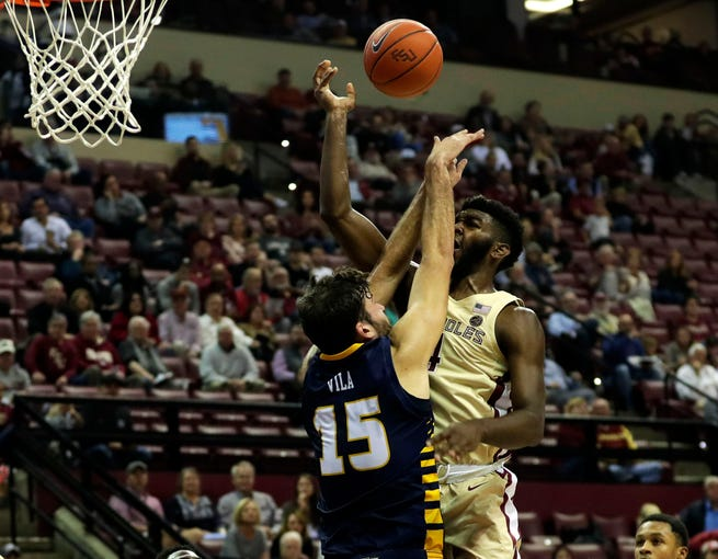 Florida State Seminoles forward Patrick Williams (4) gets hit in the face as he shoots from inside the paint. The Seminoles beat the Mocs 89-53 on Wednesday, Nov. 20, 2019.