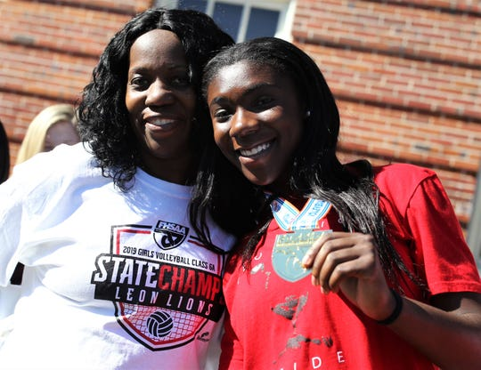 Leon senior Shania Cromartie and mother Sylvia Cromartie pose for a photo after Leon's volleyball team captured a Class 6A state championship and celebrated on its grounds on Nov. 21, 2019.