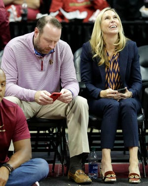 J.T. Burnette and his wife Kim Rivers sit court-side at a Florida State basketball game on Wednesday, Nov. 20, 2019.