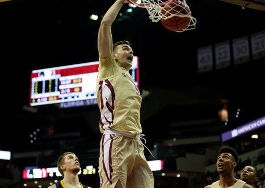 Florida State Seminoles center Balsa Koprivica (5) dunks the ball. The Seminoles beat the Mocs 89-53 on Wednesday, Nov. 20, 2019.