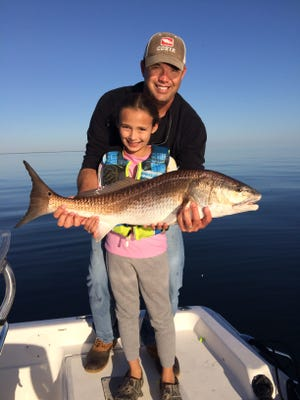 Kinsey Hough landed this Big Bull Redfish while fishing with her father Kevin.
