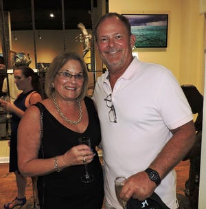Dale Bare, left, and Michael Enoch attend the VIP pre-show reception at the Geoffrey Smith Gallery prior to the Landau Eugene Murphy Jr. Concert at the Lyric Theatre in Stuart.