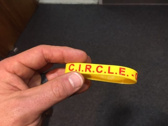 Vero Beach police Lt. Matt Harrelson, a 24-year veteran with the department, brought the CIRCLE program to Indian River County and shows off one of its very first bracelets.