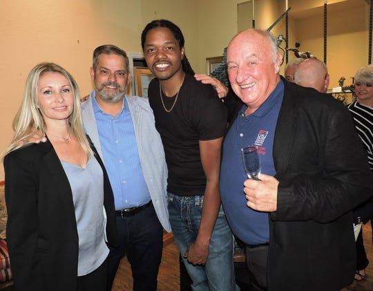 Catherine and Franz Carr, left, Landau Eugene Murphy  Jr. and Mickie Shea attend the VIP pre-show reception at the Geoffrey Smith Gallery prior to Murphy's concert at the Lyric Theatre in Stuart.