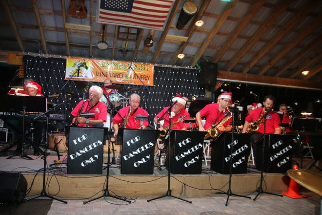Ready to belt out American Songbook and holiday favorites are members of the Fort Pierce Jazz & Blues Society's 17-piece FDO Band at the Summer Crush Winery, 4200 Johnston Road, Fort Pierce.