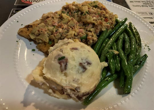 Bacon is an important ingredient at the Tin Roof Bar & Grill and the Bacon Artichoke Chicken mastered its presentation.