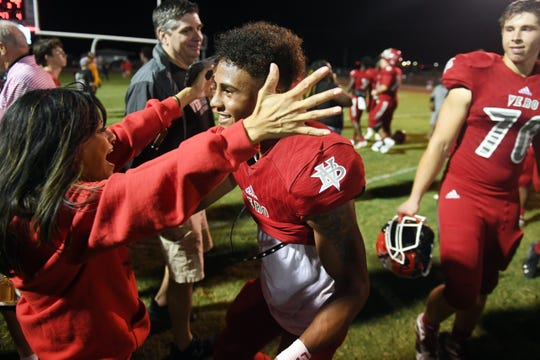 Vero Beach High School junior wide receiver Tyler Wrenn is greeted on the field by his adoptive mother Peach Whiteley on Friday, Nov. 8, 2019, after a 42-7 win over Boca Raton in a Region 3-8A quarterfinal game at the Citrus Bowl. Wrenn met the Whiteleys through youth football and eventually became a member of the family. Wrenn was officially adopted into the family in August.