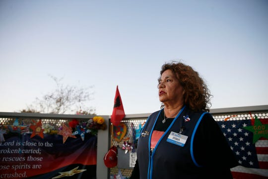 Walmart hero Irma Cano looks over the memorial site at Ponder Park on Wednesday, Nov. 20, 2019, in El Paso. Cano discussed the actions she took after she made eye contact with the gunman on Aug. 3, 2019. She credits her faith in God with helping her.