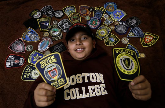 Eduardo Mier is shown with police badges given to him from departments from across the nation.