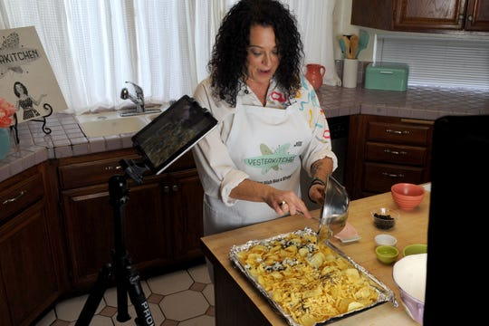 "Ventura County-based cook  Jill Hecker uses an iPad to shoot video while she prepares Cheesed Potato Chips, a recipe from the 1961 edition of ""Amy Vanderbilt's Complete Cookbook.""  Hecker features dishes from the 1940s-1980s on her YouTube channel, YesterKitchen."