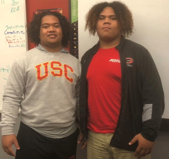The Toia brothers — Saone, left, a 6-foot-1, 290-pound senior, and Jay Toia, a 6-3, 330-pound junior — are Tongans who have made a big impact on and off the football field at Grace Brethren High.